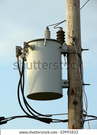 electrical power-line transformer on wooden pole