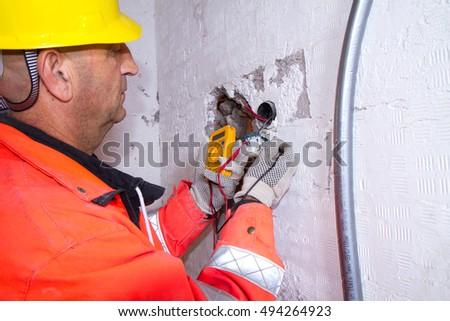 electrician at work with a plug