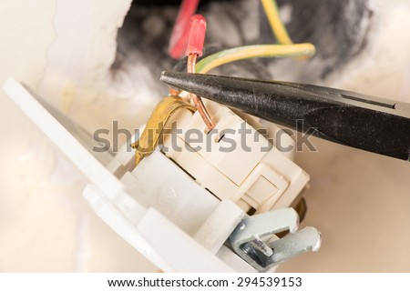 Electrician replacing old socket