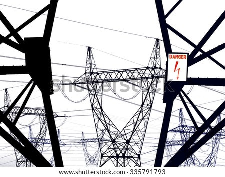 Electricity danger of death on transmission line towers black and white