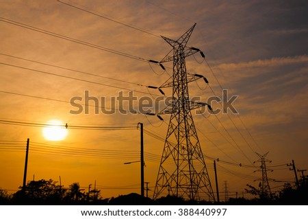 Electricity pole in sunset.Silhouette style.