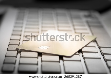 Electronic Chip on Credit card : Concept of online shopping (Selective Focus)