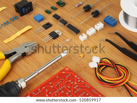 Electronic components, circuit board and hand tools for electronics assembly.