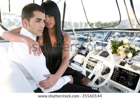 elegant couple in a yacht