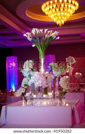Elegant floral set up for an event with candles lit