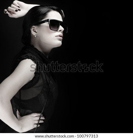 elegant sexual woman in black  clothes in fashion style