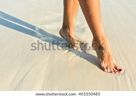 Elegant step on a sandy coral beach