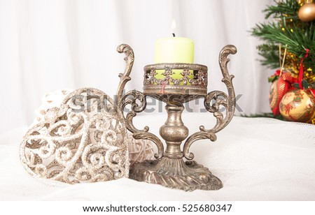 Elegant table with candlestick and Christmas decorations.