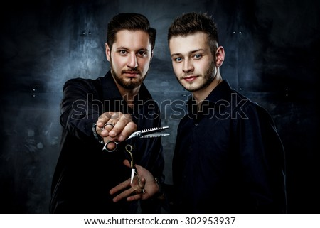 Elegant young handsome men. Man with straight razor and man holding hairdressers scisors