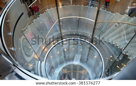Element of modern design - glass spiral staircase.