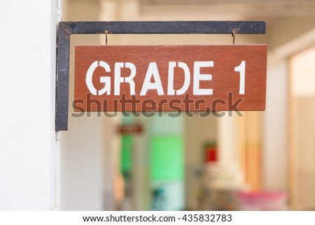 Elementary school, grade one sign at corridor outside of classroom in the morning