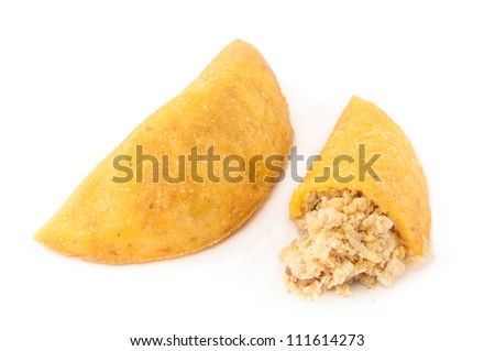 Empanadas from South America : stuffed pastries made with corn flour and filled with meat or cheese