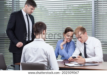 Employees don't listen to boss in office