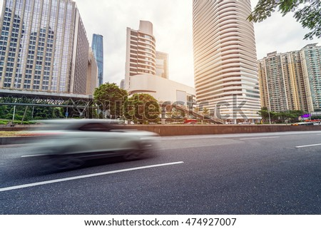 empty asphalt road and modern buildings in guangzhou