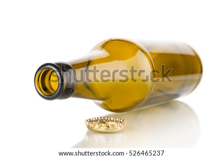 Empty beer bottle closeup on white background