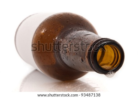 empty beer bottle on white background with reflection