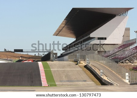 Empty car track and  bleachers before car racing
