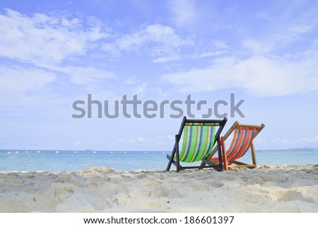 Empty chair on the sand near the sea