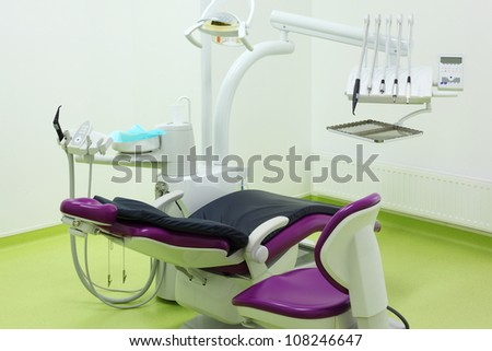 Empty dental clinic. Big and comfortable chair for patient, chair and tools for dentist.