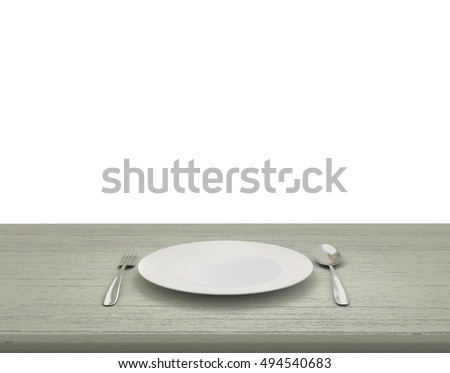 Empty Dish On The Table  On Isolated White Background