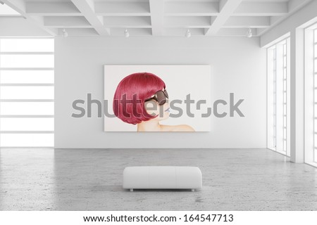 Empty exhibition hall with picture of a woman and concrete floor