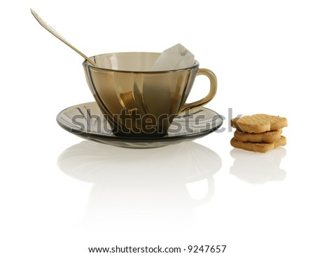 empty glass transparent cup with cookie, sugar and package tea
