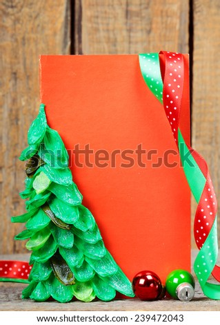 Empty greeting Christmas card on wooden background