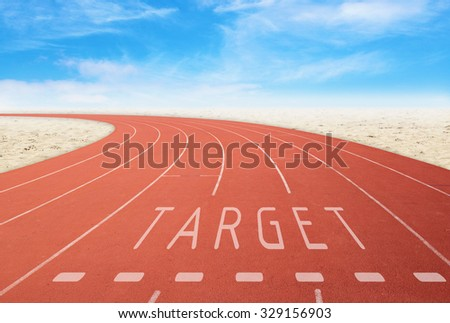 empty outdoor running track with sign target with desert and sky background