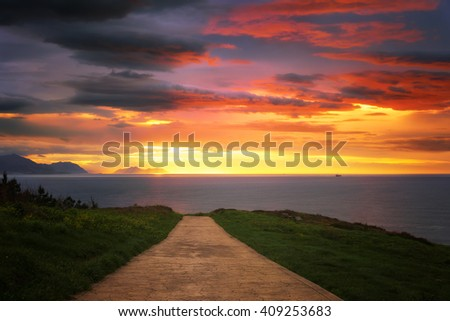 empty path near the sea at sunset