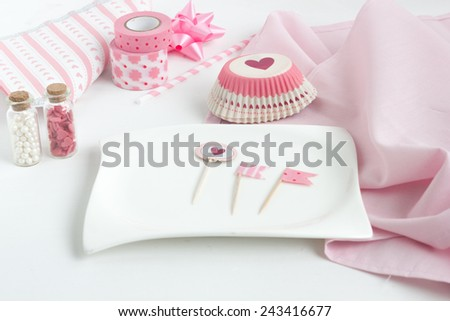 Empty plate with collection of pink cake decoration