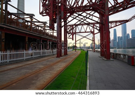 Empty road surface floor and pier of iron tower with modern city landmark architecture backgrounds in Guangzhou China