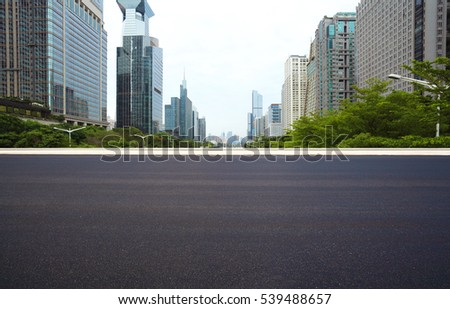 Empty road surface floor with city landmark buildings in shenzhen