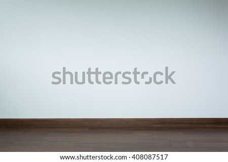 empty room interior, brown wood laminate floor and white mortar wall background