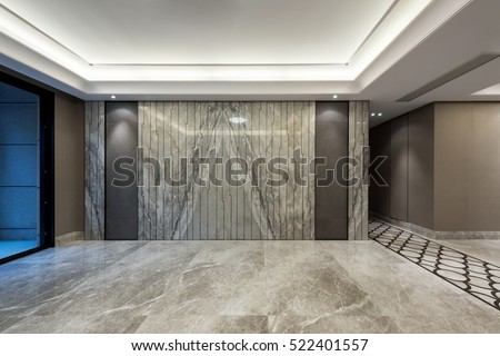 Empty room with grey marble flooring and wall decoration