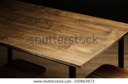 Empty rough wooden table top in the dark room