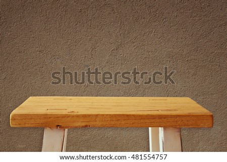 Empty small table in front of old wall background. For product display