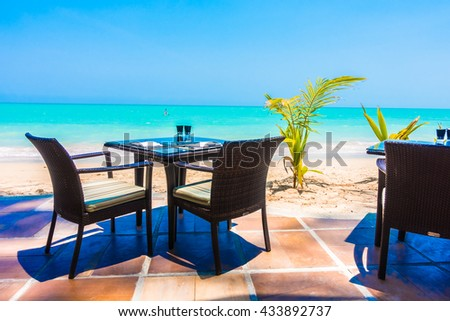 Empty table and chair on the tropical beach and sea - boost up color Processing