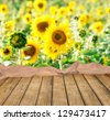 Empty table for Your photo montage with sunflowers in background. Great for summer products monatges. - stock photo