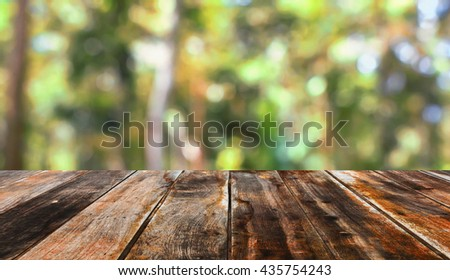 Empty table on blurred green background.