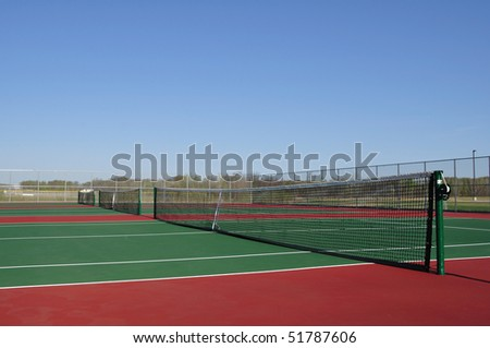 Empty Tennis Courts with a Clear Blue Sky