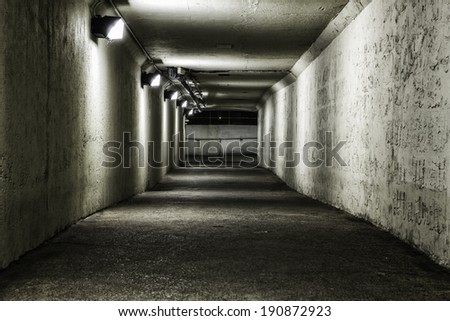 Empty tunnel at night