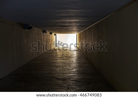Empty underpass tunnel. The light end of the tunnel. As an abstract background for creative design interesting trash, fashion and glamor