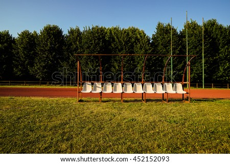 Empty vintage running track and old seats for the background with copy space