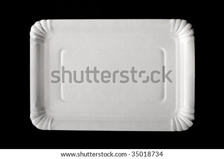 Empty white paper plate on black background