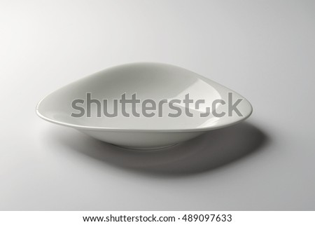 Empty White Soup Plate with a corrugated board