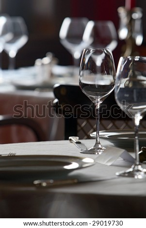 Empty wine glasses on tables in a restaurant interior
