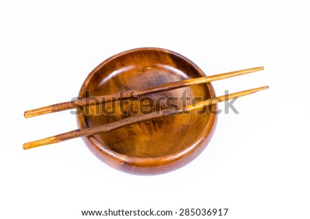 empty wooden bowl with chopsticks on white background