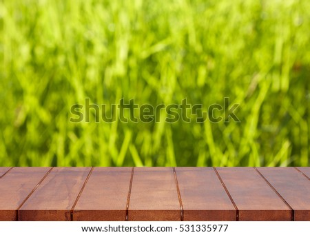Empty wooden floor. blurred bokeh nature background. There is an empty space for productions