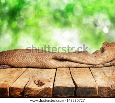 Empty wooden table and defocused green background. Great for product display montages
