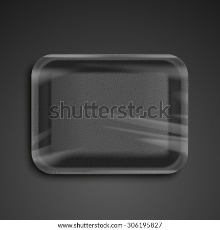empty wrapped black food tray over black background